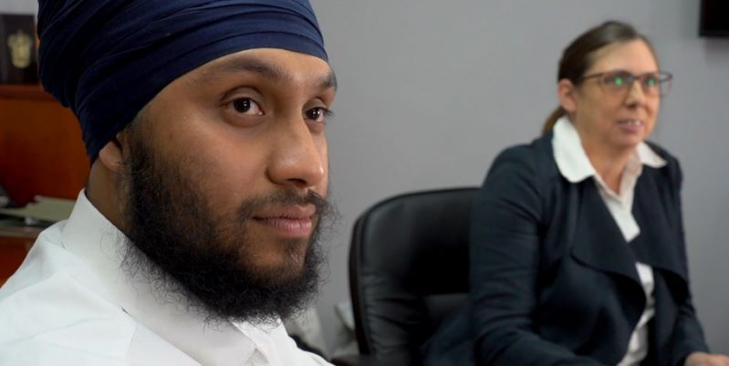 Young Sikh man and Middle Aged Lady in Boardroom